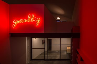 Gezellig Neon light signage, internal void space. Photography by Trevor Mein
