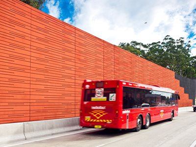 Detailed View of Terracotta Coloured Acoustic Sound Barrier on Highway