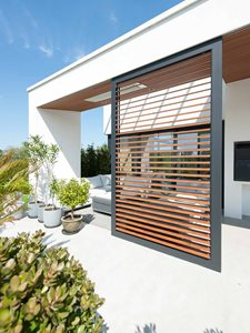 Exterior View of House With LouvreTec Timber Shutters