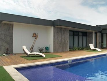The Plenty home, featuring LuxeWall panels on the exterior, is designed around a fully tiled concrete pool/spa