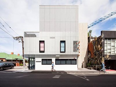 Building facade street view with fibre cement cladding