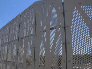 The decorative anti-throw screens were made using 5052 marine grade aluminium, powdercoated in Paperbark