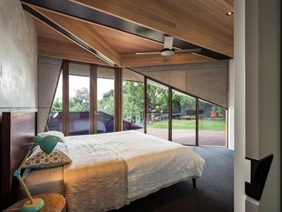 Architect lined ceiling with timber to match exterior cladding. Pelmet hidden by clever architecture detailing. Photography by Andrew Latreille