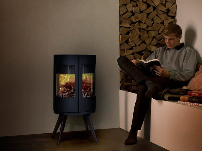 Castworks Morso Cast Iron Heater in Living Room With Man Reading in Corner