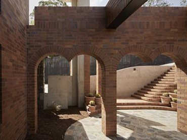 The main courtyard is framed by an imposing double archway wide enough to welcome up to 10 guests
