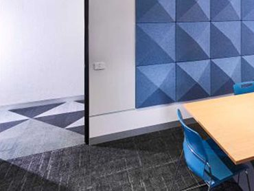 A dynamic carpet pattern with different colours and shapes was used throughout the school