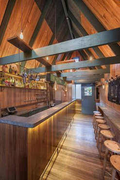 Sans Arc Studio slot timber-clad bar, courtyard and restaurant into