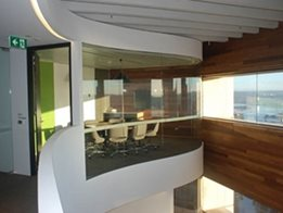 Commercial interiors and exteriors from bent and curved glass