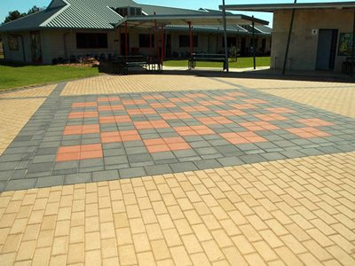 Coloured stone pavers outside school building