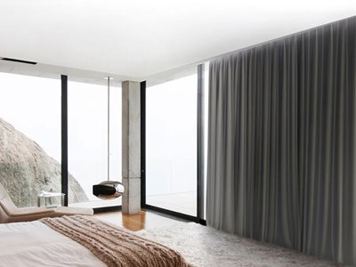 Verosol solar control sheer fabric in residential bedroom interior