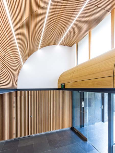 SUPASLAT timber slats create a directional flow through the new glass doors