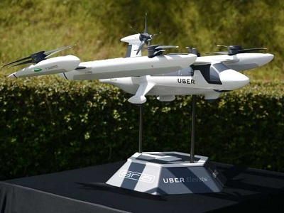 A model of Uber's electric vertical take-off and landing vehicle concept (eVTOL) flying taxi