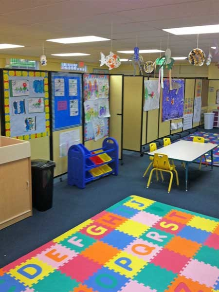 Mobile room dividers were used to create an activity space within a common space, which doubled as a day care
