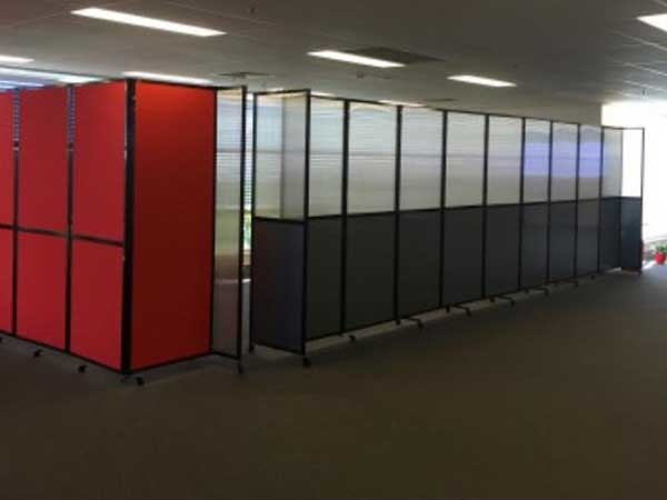 The new boardroom (8m x 4m) featuring customised red office partitions