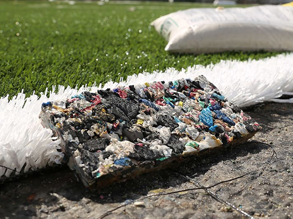 Adidas takes 1.8 million plastic bottles and turns them into a sports field
