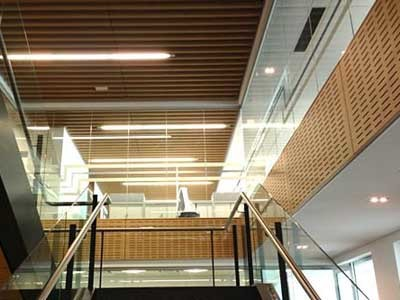 Ultraflex's slotted laminate panels were specified to cover the spandrel sections around the open stair voids between floors