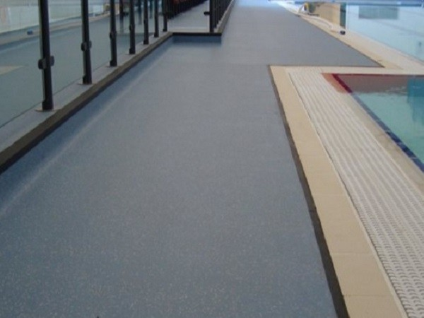 Woodhouse Grove School swimming pool facility featuring Altro Aquarius safety flooring