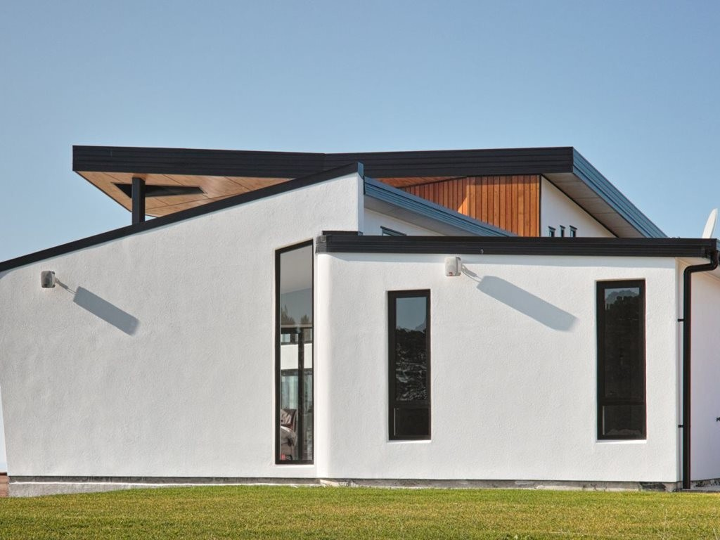Black Door House, an energy-efficient house designed by Max Capocaccia of MC Architecture Studio. Image: MC Architecture