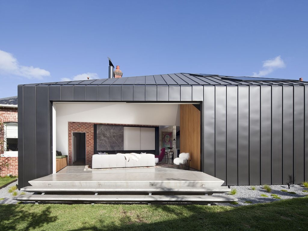 Zinc-clad addition to heritage dwelling with secret guttering
