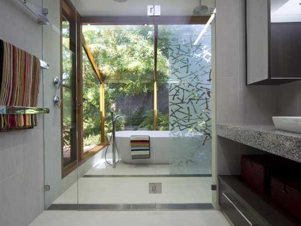 Linear grates can be located anywhere within the bathroom/shower area