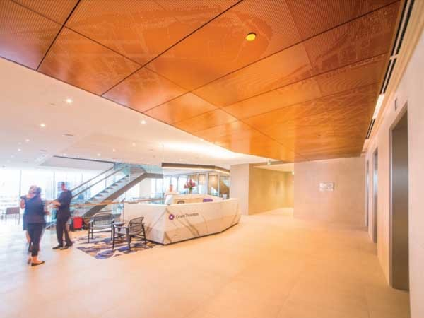 Grant Thornton's lift lobby featuring Pixels metal ceiling panels