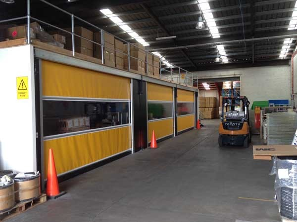 Series RL3000 high speed roll doors were installed under a mezzanine flooring structure