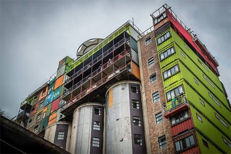 Shipping containers stacked on top of silos create student dorms in