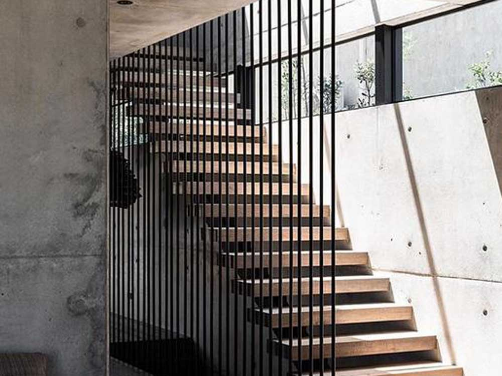 Floor-to-ceiling post balustrades by Studio Black Interiors