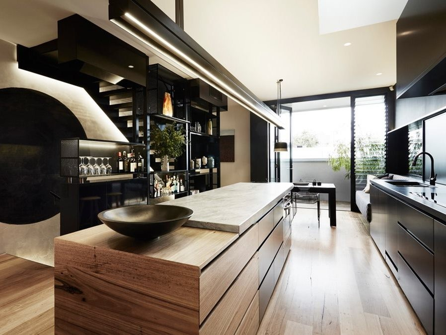 Black Moon Rising by Splinter Society Architecture features a modern kitchen. Photography by Armelle Habib