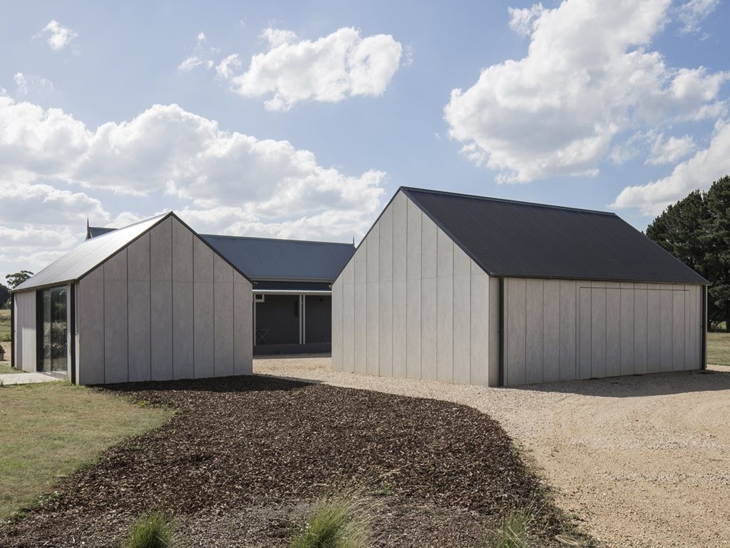 Two CFC-clad gable pavilions provide art studio and garage for Victorian farm