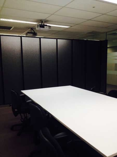 The sliding office partitions have a modern, professional feel and a tack-able fabric surface