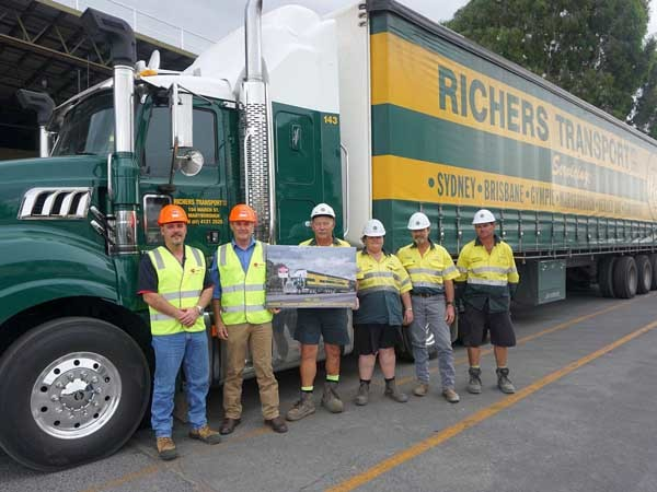Hyne Timber Tuan employees and Richers Transport with the presentation photo (Image: Hyne Timber)
