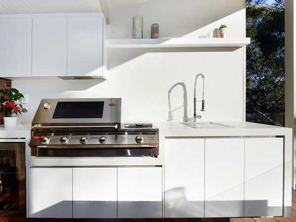 An outdoor kitchen by Granite Transformations