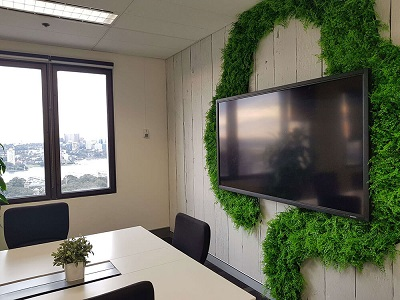 Exhibition Stand Gumtree : Corporate logo created from fern leaf green wall panels