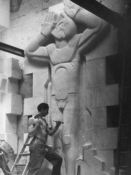 The figure 'Architectural Aspiration' is carved at the new RIBA headquarters in London (1934)