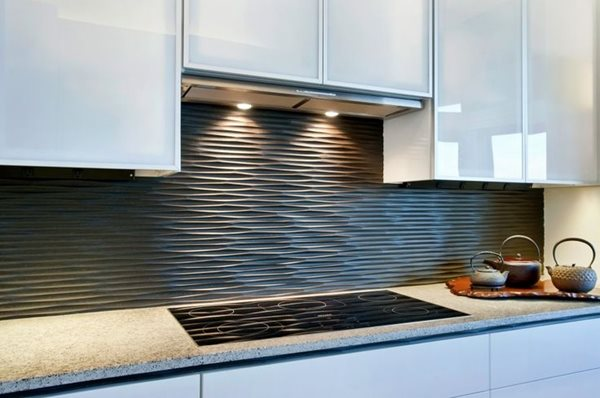 So, a splashback is better than tiles. Even if the grout in tiles will start to stain over time, a splashback will remain a smooth and easily cleaned surface.