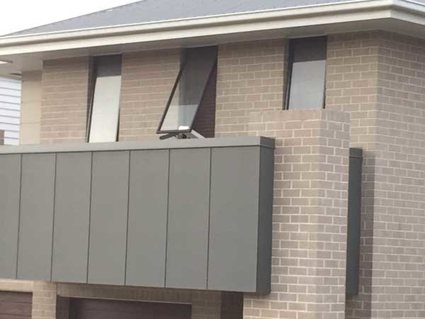 The Brisbane home with a piece of timber being used to hold the window open