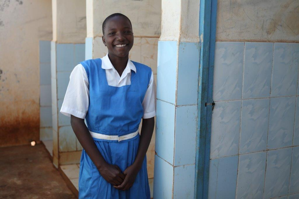 Keynan-kid-at-school-in-front-of-the-toilet-C-UNICEF-Kenya-2015-Vidyarthi-1.jpg