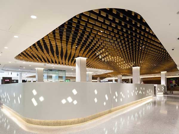 Corian products were used for cladding the feature divider walls and circular columns