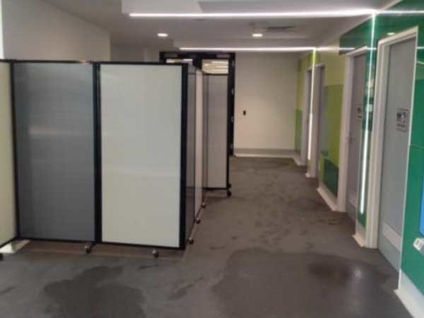 Instant mobile changing rooms were created using portable room dividers