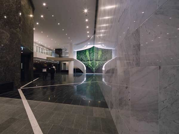 The lift lobby at the Brisbane office tower featuring finished stone