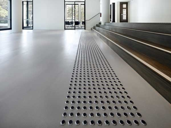 A grey PanDOMO FloorPlus product 10/3.1 was used in the Urbanest application