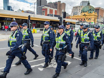 Police march down Swanston Street in Melbourne. Image: Nils Versemann/Shutterstock.com