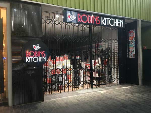 A Robin's Kitchen store featuring ATDC's concertina security door
