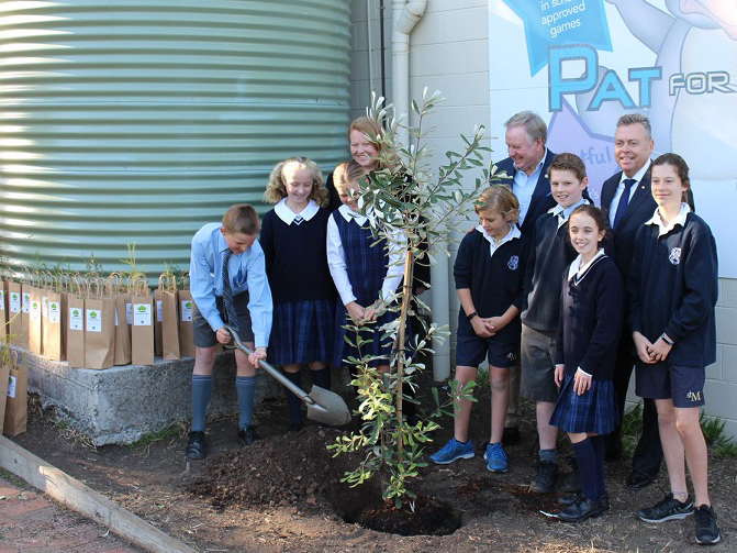 NSW minister for Planning and Housing Anthony Roberts joined students at St Michael's Catholic Primary School in Lane Cove recently to celebrate the annual tree planting day and promote the NSW Government's 5 Million Tree program. Image: Supplied
