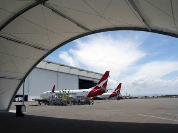 Greenline tensioned membrane structure protecting Qantas' ground support equipment