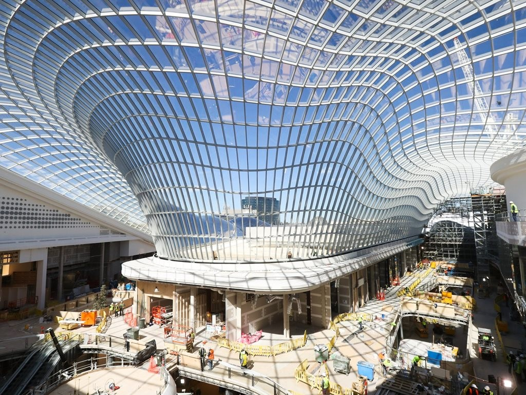 The glass gridshell roof will form a canopy of light over the shoppin centre