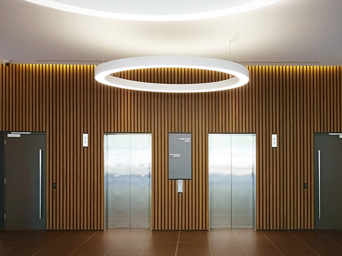 Lift foyer with timber cladding panels