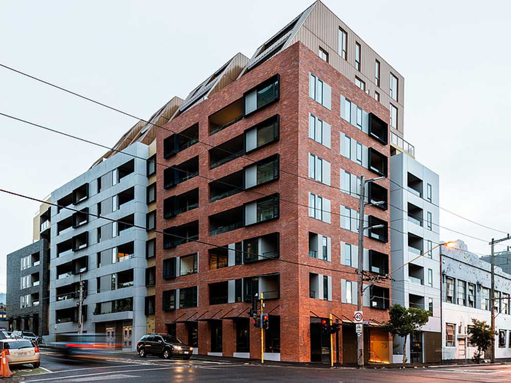 Signature facade on Collingwood apartments features brick inlay - Architecture and Design