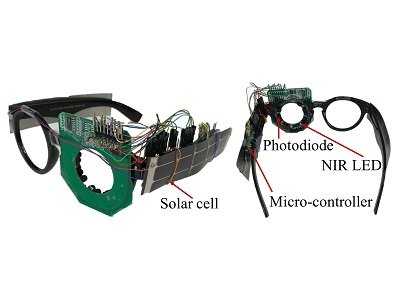 Integrating eye tracker into a regular pair of glasses, the system relies on NIR lights and photodiodes for eye tracking and is powered by two thin solar cells on the arms of the glasses. Credit: DartNets Lab